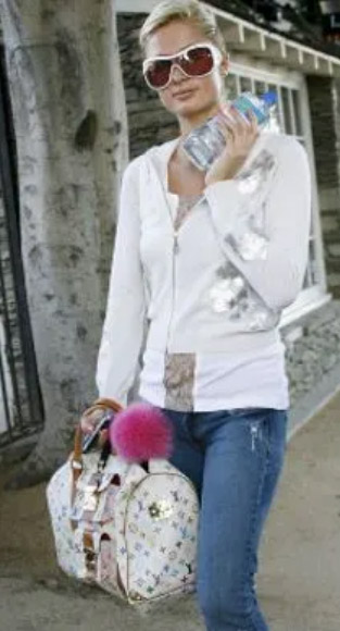 Paris Hilton Holding Louis Vuitton Multi Colored Monogram Speedy