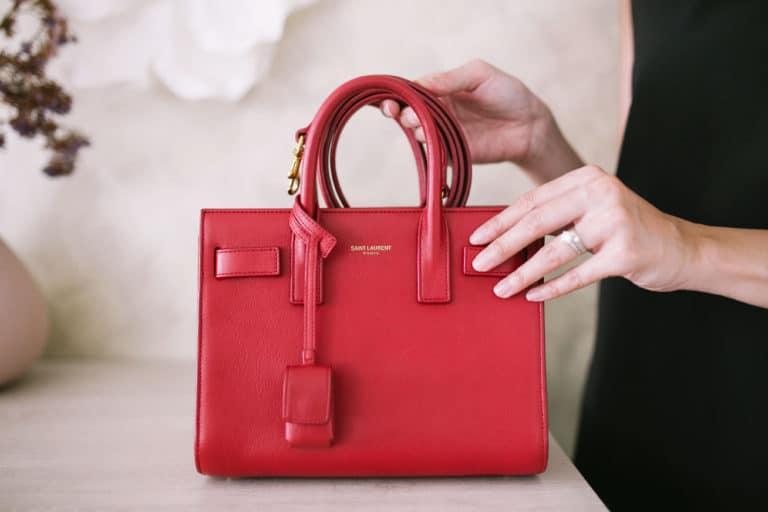 Woman Holding a Red Saint Lauren Handbag